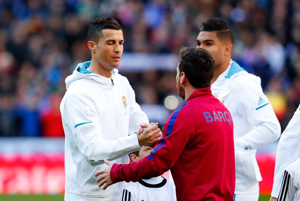 MADRID, SPAIN - DECEMBER 23: Cristiano Ronaldo of Real Madrid greets Lionel Messi of Barcelona prior to the La Liga match between Real Madrid and Barcelona at Estadio Santiago Bernabeu on December 23, 2017 in Madrid, Spain. (Photo by Gonzalo Arroyo Moreno/Getty Images)