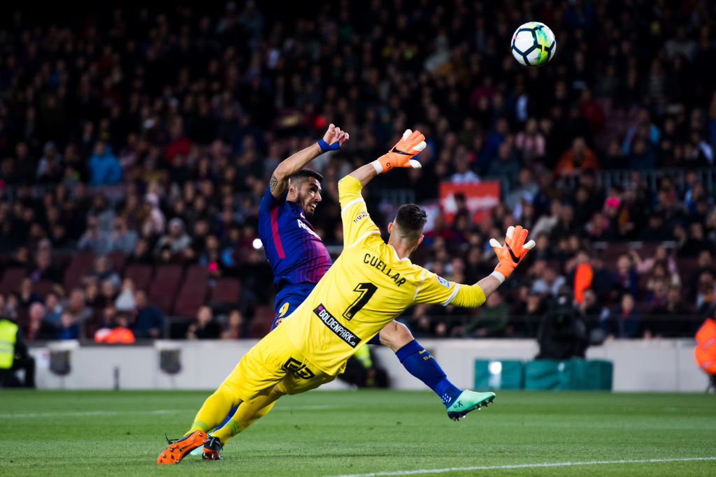 BARCELONA, SPAIN - APRIL 07: Luis Suarez of FC Barcelona shoots the ball with the opposition of Ivan Cuellar of CD Leganes during the La Liga match between Barcelona and Leganes at Camp Nou on April 7, 2018 in Barcelona, Spain. (Photo by Alex Caparros/Getty Images)