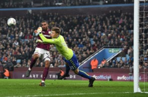 BIRMINGHAM, ENGLAND - APRIL 13: Bailey Peacock-Farrell of Leeds United makes a save from Lewis Grabban of Aston Villa during the Sky Bet Championship match between Aston Villa and Leeds United at Villa Park on April 13, 2018 in Birmingham, England. (Photo by Michael Regan/Getty Images)