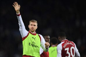 LEICESTER, ENGLAND - MAY 09: Per Mertesacker of Arsenal shows appreciation to the fans after the Premier League match between Leicester City and Arsenal at The King Power Stadium on May 9, 2018 in Leicester, England. (Photo by Shaun Botterill/Getty Images)