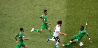 VOLGOGRAD, RUSSIA - JUNE 25: Motaz Hawsawi of Saudi Arabia tackles Mohamed Salah of Egypt during the 2018 FIFA World Cup Russia group A match between Saudia Arabia and Egypt at Volgograd Arena on June 25, 2018 in Volgograd, Russia. (Photo by Laurence Griffiths/Getty Images)