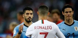 SOCHI, RUSSIA - JUNE 30: Luis Suarez of Uruguay shakes hands wuth Cristiano Ronaldo of Portugal during the 2018 FIFA World Cup Russia Round of 16 match between Uruguay and Portugal at Fisht Stadium on June 30, 2018 in Sochi, Russia. (Photo by Julian Finney/Getty Images)