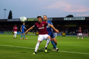 KINGSTON UPON THAMES, ENGLAND - AUGUST 28: Aaron Cresswell of West Ham United competes Scott Wagstaff of AFC Wimbledon during the Carabao Cup Second Round match between AFC Wimbledon and West Ham United at The Cherry Red Records Stadium on August 28, 2018 in Kingston upon Thames, England. (Photo by Catherine Ivill/Getty Images)