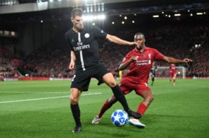 LIVERPOOL, ENGLAND - SEPTEMBER 18: Thomas Meunier of Paris Saint-Germain controls the ball under pressure from Daniel Sturridge of Liverpool during the Group C match of the UEFA Champions League between Liverpool and Paris Saint-Germain at Anfield on September 18, 2018 in Liverpool, United Kingdom. (Photo by Michael Regan/Getty Images)