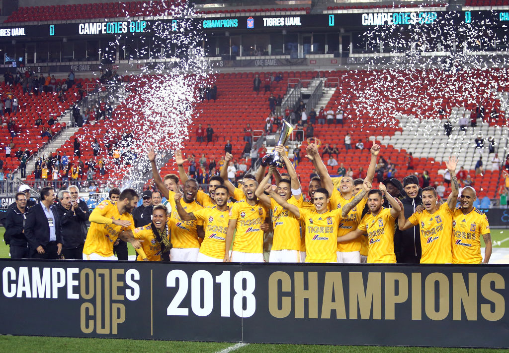 TORONTO, ON - SEPTEMBER 19: Juninho #3 of Tigres UANL lifts the 2018 Campeones Cup Final trophy after victory against Toronto FC at BMO Field on September 19, 2018 in Toronto, Canada. (Photo by Vaughn Ridley/Getty Images)