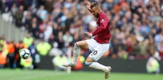 LONDON, ENGLAND - SEPTEMBER 23: Andriy Yarmolenko of West Ham United leaps over David Luiz of Chelsea during the Premier League match between West Ham United and Chelsea FC at London Stadium on September 23, 2018 in London, United Kingdom. (Photo by Dan Istitene/Getty Images)