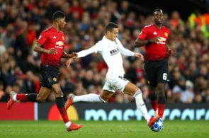 MANCHESTER, ENGLAND - OCTOBER 02: Rodrigo Moreno Machado of Valencia is challenged by Marcus Rashford of Manchester United during the Group H match of the UEFA Champions League between Manchester United and Valencia at Old Trafford on October 2, 2018 in Manchester, United Kingdom. (Photo by Clive Brunskill/Getty Images)
