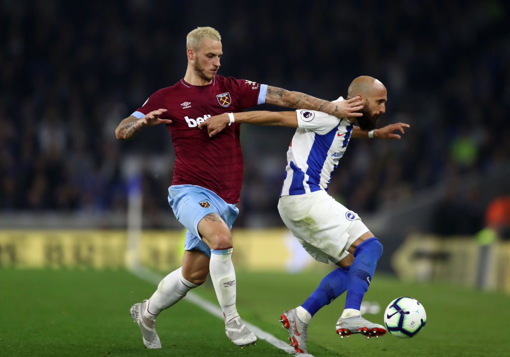 BRIGHTON, ENGLAND - OCTOBER 05: Bruno Saltor Grau of Brighton and Hove Albion battles for possession with Marko Arnautovic of West Ham United during the Premier League match between Brighton & Hove Albion and West Ham United at American Express Community Stadium on October 5, 2018 in Brighton, United Kingdom. (Photo by Bryn Lennon/Getty Images)