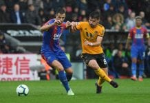 LONDON, ENGLAND - OCTOBER 06: Luka Milivojevic of Crystal Palace and Ruben Neves of Wolverhampton Wanderers battle for the ball during the Premier League match between Crystal Palace and Wolverhampton Wanderers at Selhurst Park on October 6, 2018 in London, United Kingdom. (Photo by Mike Hewitt/Getty Images)