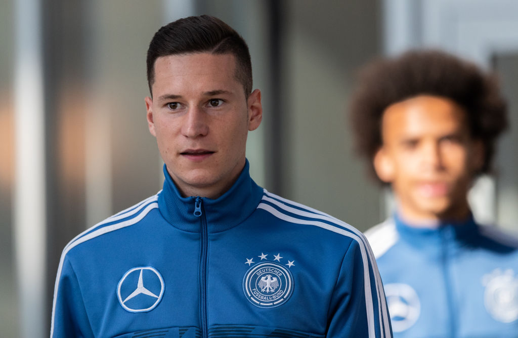 BERLIN, GERMANY - OCTOBER 10: Julian Draxler of Germany and Leroy Sane of Germany arrive for a press conference of the German national team at Mercedes-Benz am Salzufer on October 10, 2018 in Berlin, Germany. (Photo by Boris Streubel/Bongarts/Getty Images)