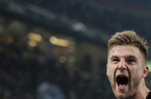MILAN, ITALY - FEBRUARY 24: Milan Skriniar of FC Internazionale Milano celebrates after scoring the opening goal during the serie A match between FC Internazionale and Benevento Calcio at Stadio Giuseppe Meazza on February 24, 2018 in Milan, Italy. (Photo by Emilio Andreoli/Getty Images )