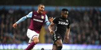 BIRMINGHAM, ENGLAND - APRIL 13: Lewis Grabban of Aston Villa challenges of Ronaldo Vieira of Leeds United during the Sky Bet Championship match between Aston Villa and Leeds United at Villa Park on April 13, 2018 in Birmingham, England. (Photo by Michael Regan/Getty Images)
