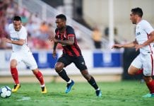 MURCIA, SPAIN - JULY 14: Borja San Emeterio of Sevilla FC (R) duels for the ball with Jermain Defoe of AFC Bournemouth during Pre- Season friendly Match between Sevilla FC and AFC Bournemouth at La Manga Club on July 14, 2018 in Murcia, Spain. (Photo by Aitor Alcalde/Getty Images)