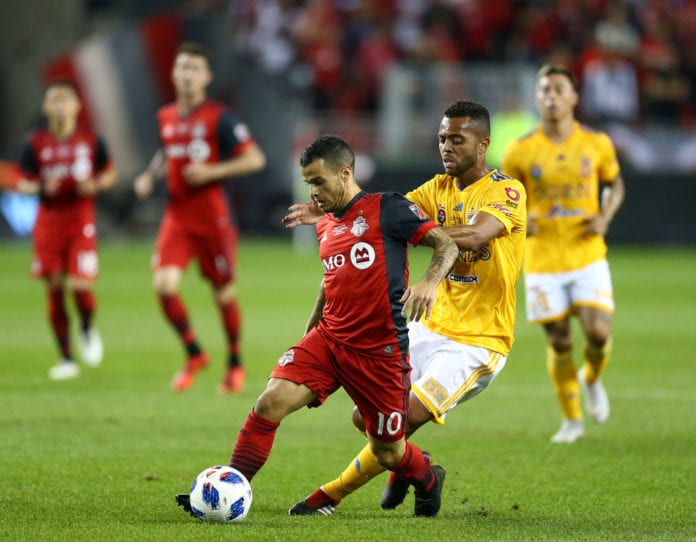 TORONTO, ON - SEPTEMBER 19: Rafael De Souza #5 of Tigres UANL battles for the ball with Sebastian Giovinco #10 of Toronto FC during the first half of the 2018 Campeones Cup Final at BMO Field on September 19, 2018 in Toronto, Canada. (Photo by Vaughn Ridley/Getty Images)