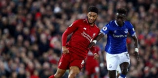 LIVERPOOL, ENGLAND - DECEMBER 02: Joe Gomez of Liverpool passes the ball under pressure from Idrissa Gueye of Everton during the Premier League match between Liverpool FC and Everton FC at Anfield on December 2, 2018 in Liverpool, United Kingdom. (Photo by Clive Brunskill/Getty Images)