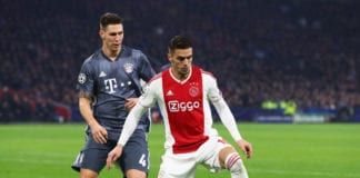 AMSTERDAM, NETHERLANDS - DECEMBER 12: Dusan Tadic of Ajax battles for the ball with Niklas Suele of Bayern Muenchen during the UEFA Champions League Group E match between Ajax and FC Bayern Munich at Johan Cruyff Arena on December 12, 2018 in Amsterdam, Netherlands. (Photo by Dean Mouhtaropoulos/Getty Images)
