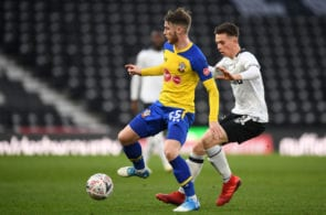 DERBY, ENGLAND - JANUARY 05: Callum Slattery of Southampton holds off Max Bird of Derby County during the FA Cup Third Round match between Derby County and Southampton at Pride Park on January 5, 2019 in Derby, United Kingdom. (Photo by Michael Regan/Getty Images)