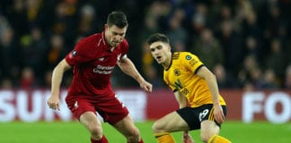 WOLVERHAMPTON, ENGLAND - JANUARY 07: James Milner of Liverpool avoids Ruben Vinagre Wolverhampton Wanderers during the Emirates FA Cup Third Round match between Wolverhampton Wanderers and Liverpool at Molineux on January 7, 2019 in Wolverhampton, United Kingdom. (Photo by Catherine Ivill/Getty Images)