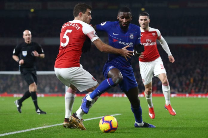 LONDON, ENGLAND - JANUARY 19: Antonio Ruediger of Chelsea battles for possession with Sokratis Papastathopoulos of Arsenal during the Premier League match between Arsenal FC and Chelsea FC at Emirates Stadium on January 19, 2019 in London, United Kingdom. (Photo by Clive Rose/Getty Images)