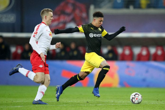 LEIPZIG, GERMANY - JANUARY 19: Jadon Sancho of Borussia Dortmund runs with the ball during the Bundesliga match between RB Leipzig and Borussia Dortmund at Red Bull Arena on January 19, 2019 in Leipzig, Germany. (Photo by Adam Pretty/Bongarts/Getty Images)