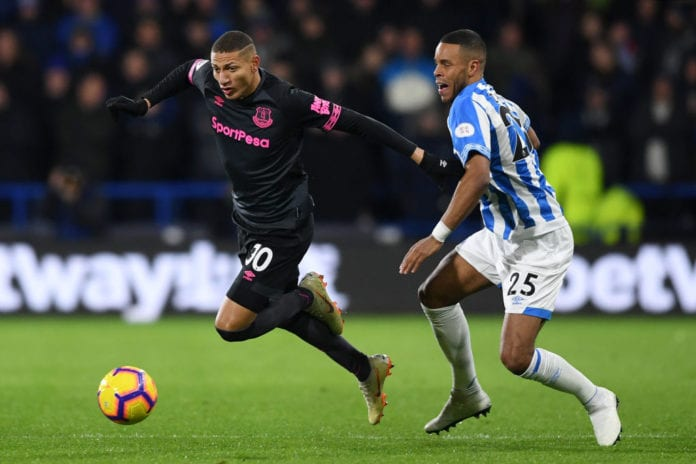 HUDDERSFIELD, ENGLAND - JANUARY 29: Richarlison of Everton is challenged by Mathias Zanka Jorgensen of Huddersfield Town during the Premier League match between Huddersfield Town and Everton at John Smith's Stadium on January 29, 2019 in Huddersfield, United Kingdom. (Photo by Gareth Copley/Getty Images)