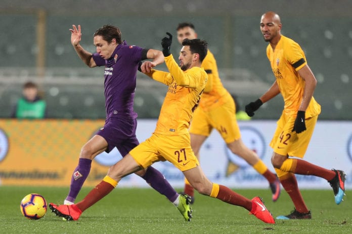FLORENCE, ITALY - JANUARY 30: Federico Chiesa of ACF Fiorentina in action against Javier Pastore of AS Roma during the Coppa Italia match between ACF Fiorentina and AS Roma at Stadio Artemio Franchi on January 30, 2019 in Florence, Italy. (Photo by Gabriele Maltinti/Getty Images)