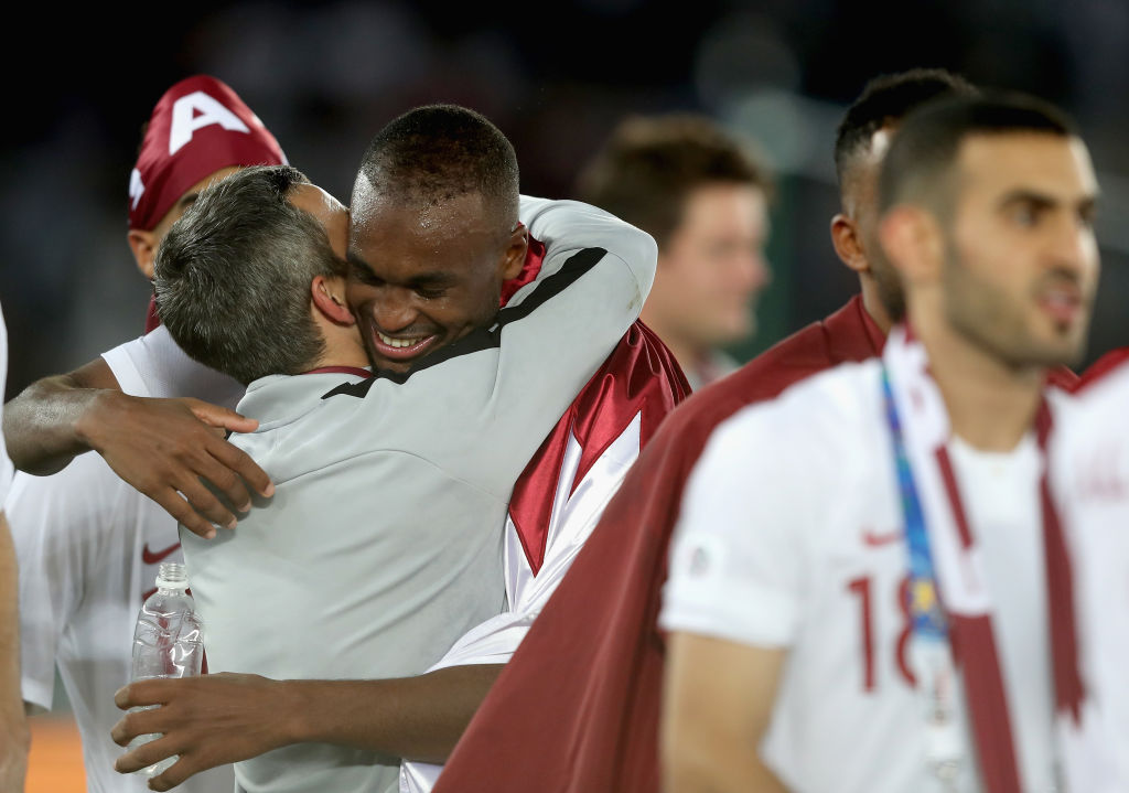 ABU DHABI, UNITED ARAB EMIRATES - FEBRUARY 01: Abdelkarim Hassan of Qatar celebrates with a teammate following their sides victory during the AFC Asian Cup final match between Japan and Qatar at Zayed Sports City Stadium on February 1, 2019 in Abu Dhabi, United Arab Emirates. (Photo by Francois Nel/Getty Images)