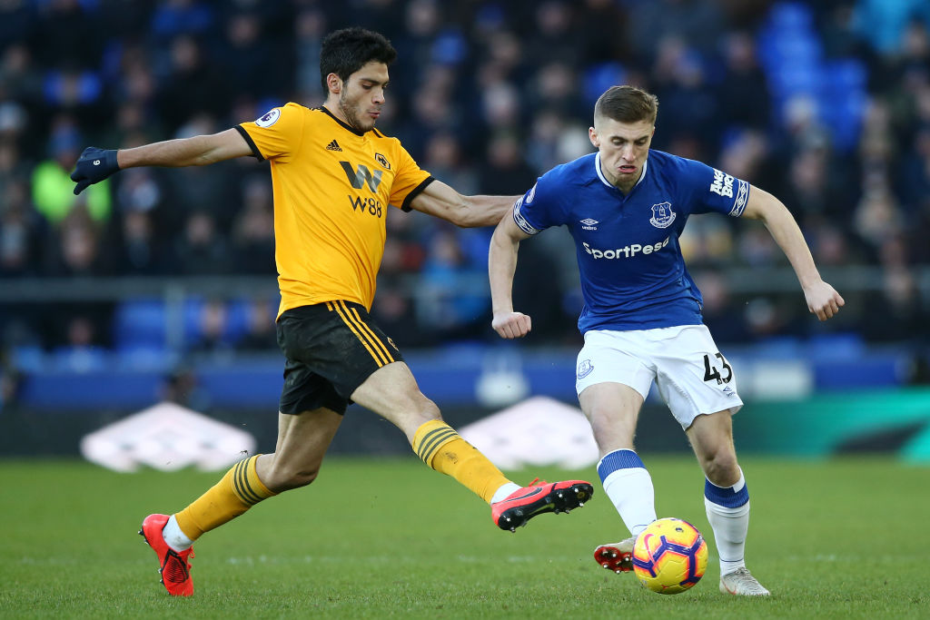 LIVERPOOL, ENGLAND - FEBRUARY 02: Jonjoe Kenny of Everton shoots while challanged by Raul Jimenez of Wolverhampton Wanderers during the Premier League match between Everton FC and Wolverhampton Wanderers at Goodison Park on February 2, 2019 in Liverpool, United Kingdom. (Photo by Jan Kruger/Getty Images)