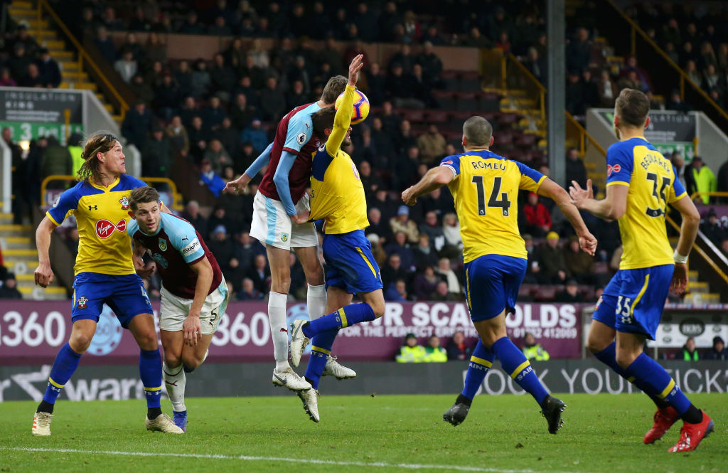 BURNLEY, ENGLAND - FEBRUARY 02: Peter Crouch of Burnley is fouled by Jack Stephens of Southampton and a penalty is later awarded to Burnley during the Premier League match between Burnley FC and Southampton FC at Turf Moor on February 2, 2019 in Burnley, United Kingdom. (Photo by Alex Livesey/Getty Images)