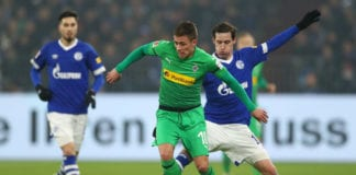 GELSENKIRCHEN, GERMANY - FEBRUARY 02: Thorgan Hazard of Borussia Monchengladbach is challenged by Sebastian Rudy of FC Schalke 04 during the Bundesliga match between FC Schalke 04 and Borussia Moenchengladbach at Veltins-Arena on February 2, 2019 in Gelsenkirchen, Germany. (Photo by Lars Baron/Bongarts/Getty Images)