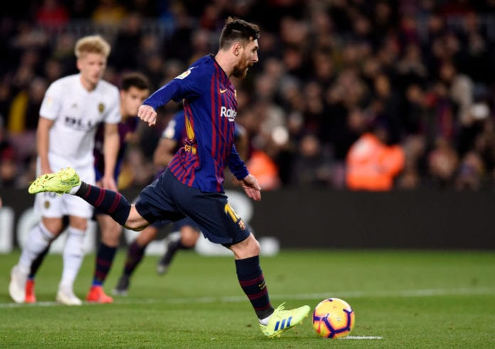 BARCELONA, SPAIN - FEBRUARY 02: Lionel Messi of Barcelona scores his team's first goal from the penalty spot during the La Liga match between FC Barcelona and Valencia CF at Camp Nou on February 2, 2019 in Barcelona, Spain. (Photo by Alex Caparros/Getty Images)