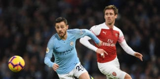MANCHESTER, ENGLAND - FEBRUARY 03: Bernardo Silva of Manchester City evades Nacho Monreal of Arsenal during the Premier League match between Manchester City and Arsenal FC at Etihad Stadium on February 3, 2019 in Manchester, United Kingdom. (Photo by Stu Forster/Getty Images)