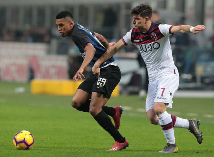 MILAN, ITALY - FEBRUARY 03: Henrique Dalbert of FC Internazionale is challenged by Riccardo Orsolini of Bologna FC during the Serie A match between FC Internazionale and Bologna FC at Stadio Giuseppe Meazza on February 3, 2019 in Milan, Italy. (Photo by Emilio Andreoli/Getty Images)