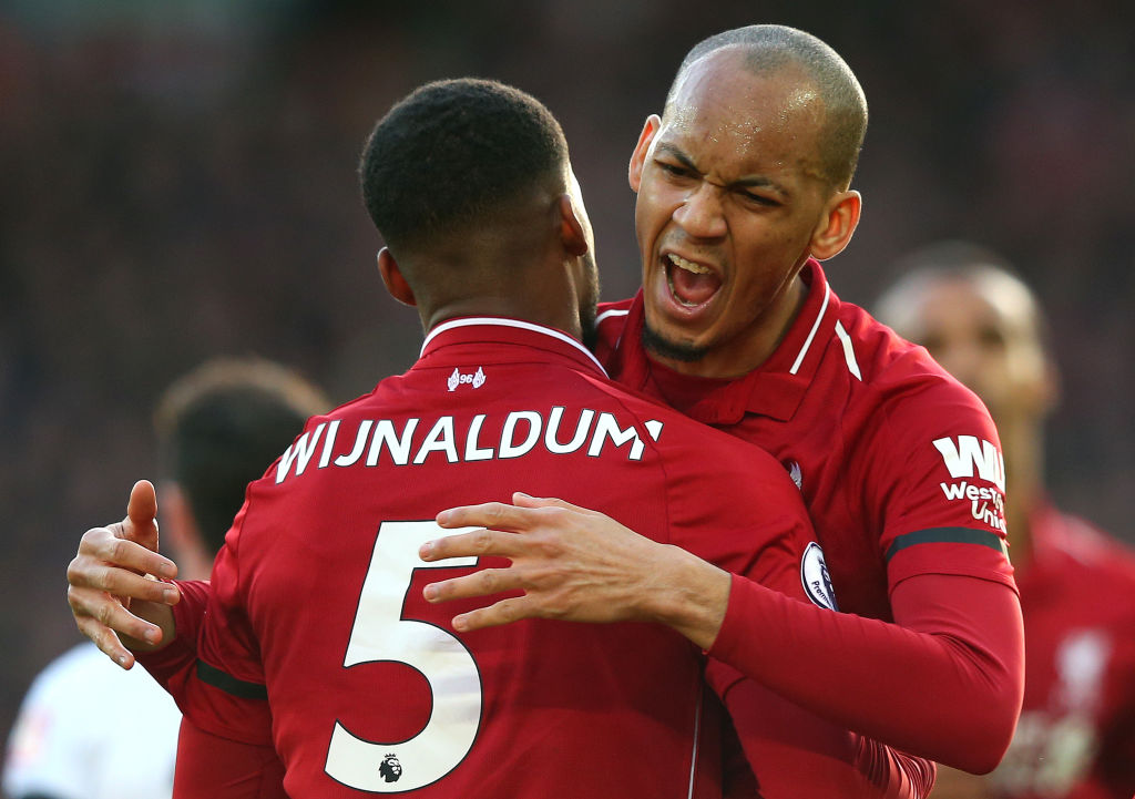 LIVERPOOL, ENGLAND - FEBRUARY 09: Georginio Wijnaldum of Liverpool celebrates after scoring his team's second goal with teammate Fabinho during the Premier League match between Liverpool FC and AFC Bournemouth at Anfield on February 9, 2019 in Liverpool, United Kingdom. (Photo by Alex Livesey/Getty Images)