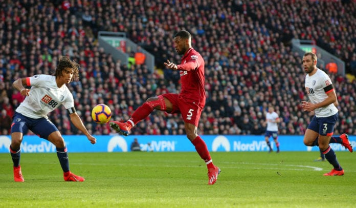 LIVERPOOL, ENGLAND - FEBRUARY 09: Georginio Wijnaldum of Liverpool scores his team's second goal under pressure from Nathan Ake of AFC Bournemouth during the Premier League match between Liverpool FC and AFC Bournemouth at Anfield on February 9, 2019 in Liverpool, United Kingdom. (Photo by Alex Livesey/Getty Images)