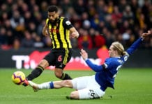 WATFORD, ENGLAND - FEBRUARY 09: Adrian Mariappa of Watford in action with Tom Davies of Everton during the Premier League match between Watford FC and Everton FC at Vicarage Road on February 9, 2019 in Watford, United Kingdom. (Photo by Marc Atkins/Getty Images)
