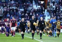 EDINBURGH, SCOTLAND - FEBRUARY 10: The referee leads the teams out prior to the Scottish Cup 5th Round match between Heart of Midlothian and Auchinleck Talbot at Tynecastle Stadium on February 10, 2019 in Edinburgh, Scotland. (Photo by Ian MacNicol/Getty Images)