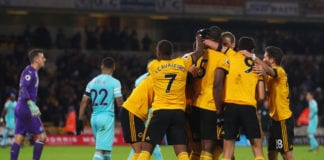 WOLVERHAMPTON, ENGLAND - FEBRUARY 11: Willy Boly of Wolverhampton Wanderers celebrates with team mates as he scores his team's first goal during the Premier League match between Wolverhampton Wanderers and Newcastle United at Molineux on February 11, 2019 in Wolverhampton, United Kingdom. (Photo by Catherine Ivill/Getty Images)