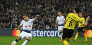 LONDON, ENGLAND - FEBRUARY 13: Harry Winks of Tottenham Hotspur shoots during the UEFA Champions League Round of 16 First Leg match between Tottenham Hotspur and Borussia Dortmund at Wembley Stadium on February 13, 2019 in London, England. (Photo by Mike Hewitt/Getty Images)