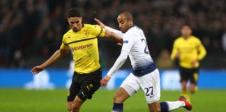 LONDON, ENGLAND - FEBRUARY 13: Lucas Moura of Tottenham Hotspur is challenged by Achraf Hakimi of Borussia Dortmund during the UEFA Champions League Round of 16 First Leg match between Tottenham Hotspur and Borussia Dortmund at Wembley Stadium on February 13, 2019 in London, England. (Photo by Clive Rose/Getty Images)
