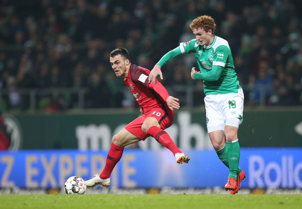 BREMEN, GERMANY - JANUARY 26: (L-R) Filip Kostic of Eintracht Frankfurt and Josh Sargent of Werder Bremen battle for the ball during the Bundesliga match between SV Werder Bremen and Eintracht Frankfurt at Weserstadion on January 26, 2019 in Bremen, Germany. (Photo by Cathrin Mueller/Bongarts/Getty Images)