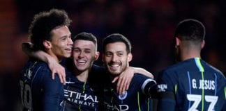NEWPORT, WALES - FEBRUARY 16: Leroy Sane of Manchester City celebrates with teammates after scoring his team's first goal during the FA Cup Fifth Round match between Newport County AFC and Manchester City at Rodney Parade on February 16, 2019 in Newport, United Kingdom. (Photo by Harry Trump/Getty Images)