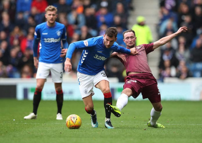 GLASGOW, SCOTLAND - FEBRUARY 16: Borna Barisic of Rangers vies with Chris Kane of St Johnstone during the Ladbrookes Scottish Premiership match between Rangers and St Johnstone at Ibrox Stadium on February 16, 2019 in Glasgow, Scotland. (Photo by Ian MacNicol/Getty Images)