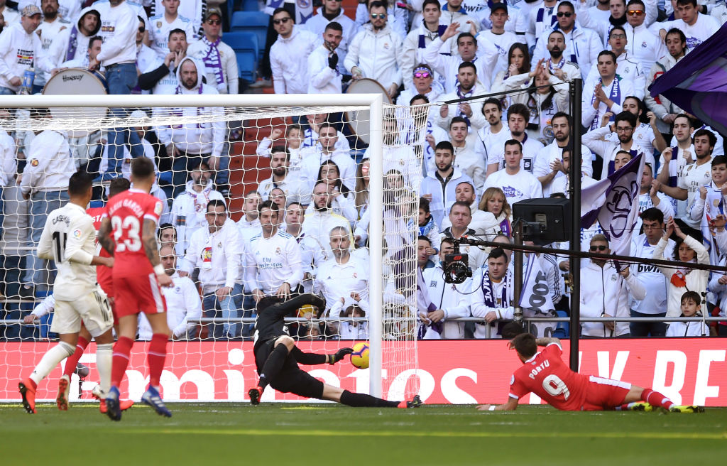 MADRID, SPAIN - FEBRUARY 17: Portu of Girona scores his team's second goal during the La Liga match between Real Madrid CF and Girona FC at Estadio Santiago Bernabeu on February 17, 2019 in Madrid, Spain. (Photo by Denis Doyle/Getty Images)