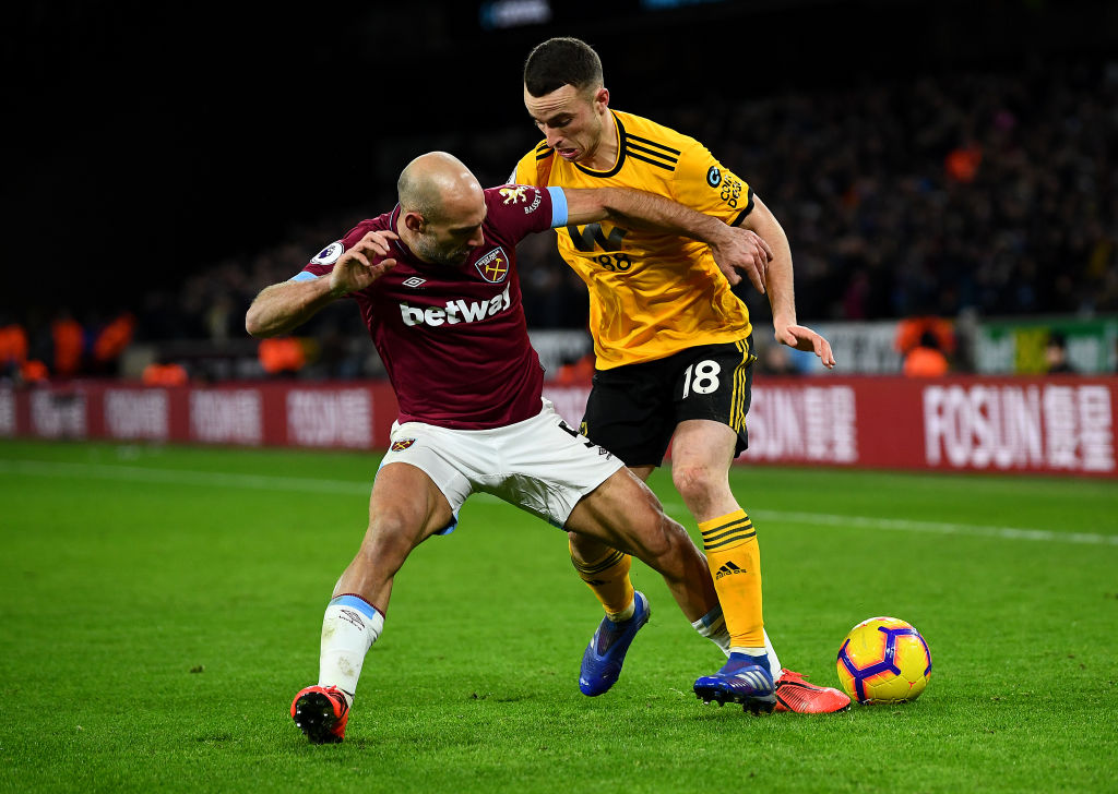 WOLVERHAMPTON, ENGLAND - JANUARY 29: Diogo Jota of Wolverhampton Wanderers is tackled by Pablo Zabaleta of West Ham United during the Premier League match between Wolverhampton Wanderers and West Ham United at Molineux on January 29, 2019 in Wolverhampton, United Kingdom. (Photo by Clive Mason/Getty Images)