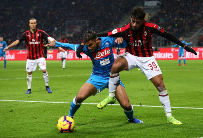 MILAN, ITALY - JANUARY 29: Lucas Paqueta (R) of AC Milan competes for the ball with Adam Ounas (L) of SSC Napoli during the Coppa Italia match between AC Milan and SSC Napoli at Stadio Giuseppe Meazza on January 29, 2019 in Milan, Italy. (Photo by Marco Luzzani/Getty Images)
