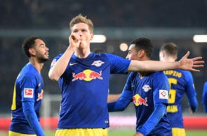 HANOVER, GERMANY - FEBRUARY 01: Marcel Halstenberg of RB Leipzig celebrates after scoring his team's first goal from the penalty spot during the Bundesliga match between Hannover 96 and RB Leipzig at HDI-Arena on February 01, 2019 in Hanover, Germany. (Photo by Stuart Franklin/Bongarts/Getty Images)