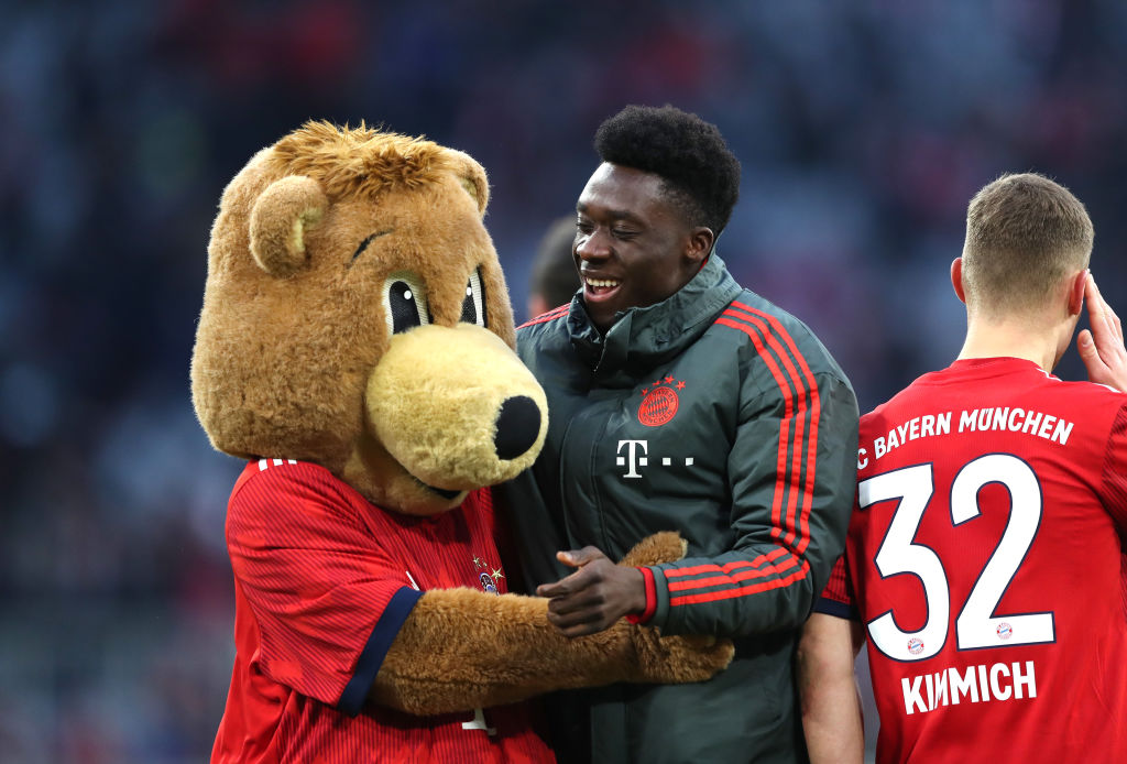 MUNICH, GERMANY - FEBRUARY 23: Alphonso Davies of Bayern Munich with mascot following the Bundesliga match between FC Bayern Muenchen and Hertha BSC at Allianz Arena on February 23, 2019 in Munich, Germany. (Photo by Christian Kaspar-Bartke/Bongarts/Getty Images)