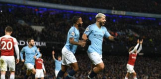 MANCHESTER, ENGLAND - FEBRUARY 03: Manchester City striker Sergio Aguero (r) celebrates with Raheem Sterling after scoring his hat trick goal despite the efforts of Arsenal goalkeeper Bernd Leno and Laurent Koscielny during the Premier League match between Manchester City and Arsenal FC at Etihad Stadium on February 03, 2019 in Manchester, United Kingdom. (Photo by Stu Forster/Getty Images)