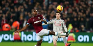 LONDON, ENGLAND - FEBRUARY 04: Andy Robertson of Liverpool shoots while challenged by Michail Antonio of West Ham United during the Premier League match between West Ham United and Liverpool FC at London Stadium on February 04, 2019 in London, United Kingdom. (Photo by Catherine Ivill/Getty Images)
